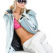 Blonde in a sports jacket and glasses — Stockfoto