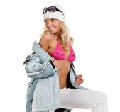 Beautiful girl in a sports jacket and hat — Stock Photo