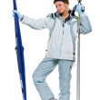 Winter sexy girl in grey sports suit and with skis — Stock Photo #32944999