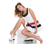 Winter sexy girl in skates and short dress — Stock Photo