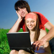 Girl with notebook and with boy on grass — Stock Photo #48138701