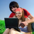 Long-haired girl with notebook and boy on grass — Stock Photo #48139955