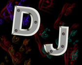 English letters DJ screwed to the background bolts — Stock Photo