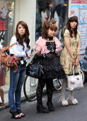 Gothic lolitas standing in the street — Stock Photo