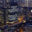 Night photo of modern cityscape, central Osaka, japan — Foto de Stock