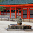 Stone Dragon Fountain with Japanese Shrine in the background — Stock Photo
