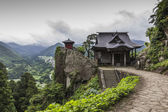 A view of japanese buddhist temple in Yamadera with beautiful landscape in the background — Stock Photo