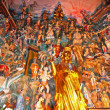 Colourful buddhist statues at the back of an altar in a temple, — Stock Photo