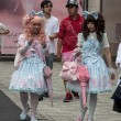 Stock Photo: Gothic lolitas walking in street