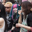 A young subcultural couple standing in the crowd in Harajuku di — Stock Photo