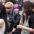 Stock Photo: Young subcultural couple standing in crowd in Harajuku di