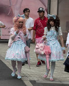 Gothic lolitas walking in the street — Stock Photo