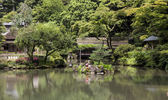 Fragment of a Japanese garden with artificial stone islands in t — Stock Photo