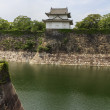 Fragments of Osaka Castle with big moat in the foreground in Osa — Stock Photo