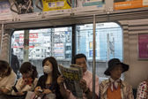 Passangers in a tube carriage in Tokyo, Japan. — Photo