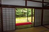 Japanese garden with stone garden seen through the sliding doors — Stock Photo