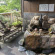 Purification ladles and bonsai trees in the Kanazawa old town, J — Stock Photo