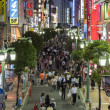 Brightly lit street in East Shinjuku, Tokyo, Japan. — Stock Photo