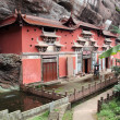 Stock Photo: Temple building leaning against vertical rock in Qiyun Taoist
