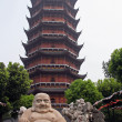 Smiling buddha statue in front of a distorted Ruigang pagodda, S — Stock Photo