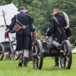 Foto de Stock  : History fans dressed as 17th century mercenary move historical c