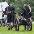 Stok fotoğraf: History fans dressed as 17th century mercenary move historical c