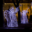 Stock Photo: Christmas street decorations - angels playing trumpets made of l