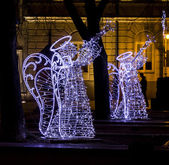 Christmas street decorations - angels playing trumpets made of l — Stock Photo