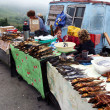 Roadside stalls with smoked fish including the amous Baikal omul — Stock Photo #37972827