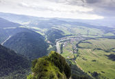 Aerial view of mountains, rivers, fields and meadows — Stock Photo