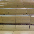 Fragment of lecture hall with empty rows of wooden desks — Stockfoto