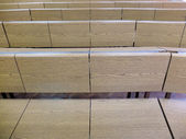 Fragment of lecture hall with empty rows of wooden desks — Stock Photo