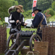 Stock Photo: History fans dressed as 17th century mercenary soldiers load his