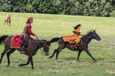 History fans dressed as 17th century Polish gentry ride on horse — Stock Photo