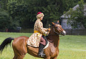 History fan dressed as 17th century Polish cavalryman with a sab — Stock Photo