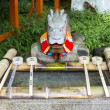 Stock Photo: Purification ladles and dragon statue in shinto shrine in Ja