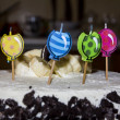 Birthday cake with four candles decorated with banana and chocol — Stock Photo