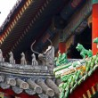 Qilin and dragon figurines adorn roof of lamtemple in Be — Stock Photo #41120911
