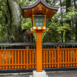 Ornamental orange wooden lantern at japanese shinto shrine — Stock Photo #41767219