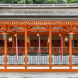 Traditional shinto architecture and stone lanterns at Fushimi In — Stock Photo #41767301