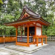 Traditional shinto architecture and stone lanterns at Fushimi In — Stock Photo #41767453