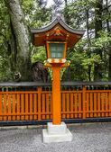 Ornamental orange wooden lantern at a japanese shinto shrine — Stock Photo
