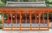 Traditional shinto architecture and stone lanterns at Fushimi In — Stock Photo