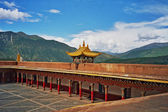 Oil painting stylized photo of  tibetan monastery in Xiancheng,  — Stock Photo