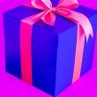 Blue present box with red ribbon isolated — Stock Photo