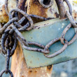 Old rusty padlock holding chain — Stock Photo