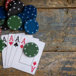 Four aces with casino chips over wooden table — Stock Photo