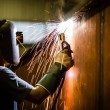 Worker with protective mask welding metal and sparks  — Stock Photo