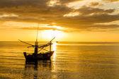 Boat at sunrise — Stock Photo