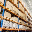 Rows of shelves with boxes in modern warehouse — Stock Photo